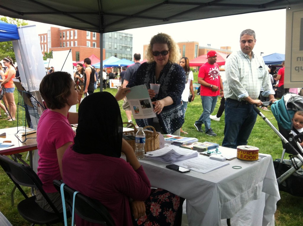 VRG Interns, Myrial Holbrook (left) and Navaal Mahdi (right) hand out copies of The Vegetarian Journal at at Baltimore VegFest 2015.